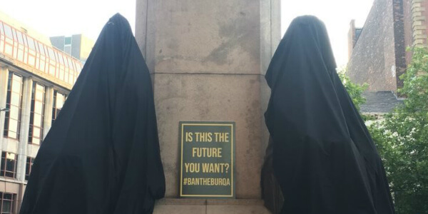 Far-right group targets famous statues in 'ban the burqa' protest