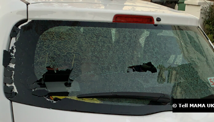 Muslim children in tears as moped driver smashes the rear windscreen of their family car